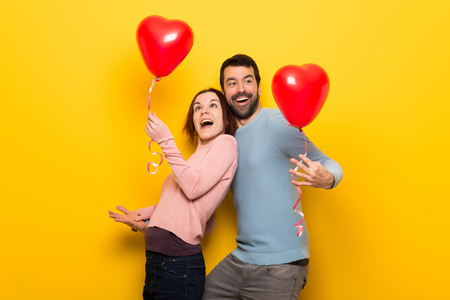 Couple in valentine day with balloons with heart shape Stock Photo