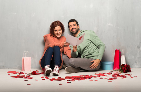 Couple in valentine day with valentines day card Stock Photo