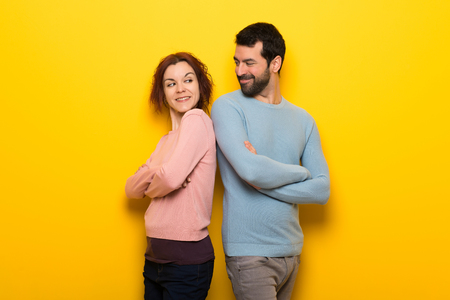 Couple in valentine day keeping the arms crossed looking at each other Stock Photo