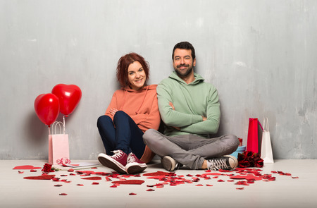 Couple in valentine day keeping the arms crossed