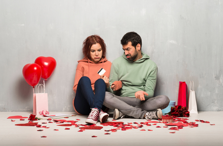 Couple in valentine day taking a credit card without money
