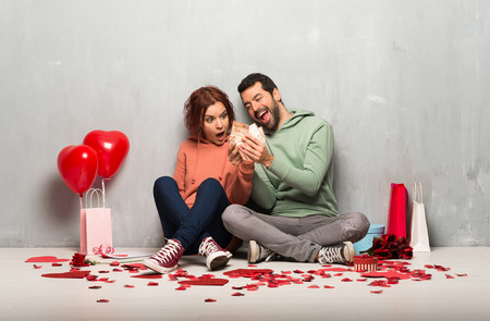 Couple in valentine day taking a lot of money
