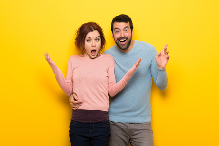 Couple in valentine day with surprise and shocked facial expression