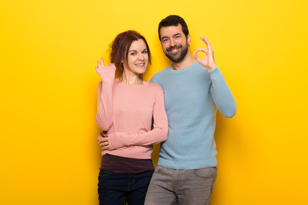Couple in valentine day showing an ok sign with fingers Stock Photo