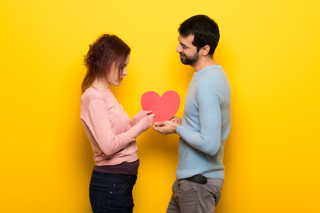 Couple in valentine day holding gift box Stock Photo