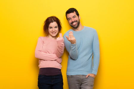 Couple in valentine day inviting to come with hand