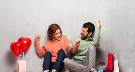 Couple in valentine day celebrating a victory in winner position Stock Photo
