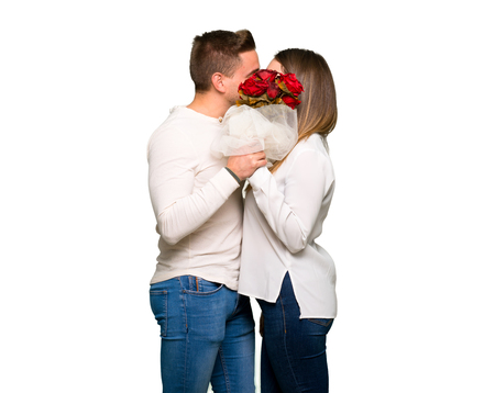 Couple in valentine day with flowers and kissing