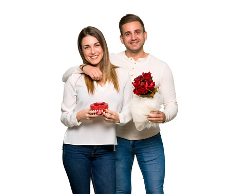 Couple in valentine day with flowers and gifts 스톡 콘텐츠