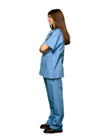 Full-length shot of Young nurse in lateral position on isolated white background 免版税图像