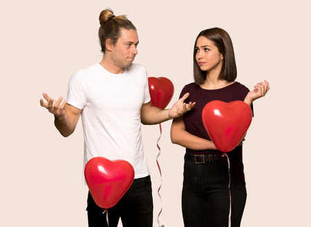 Couple in valentine day having doubts over isolated background