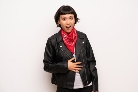 Woman with leather jacket and handkerchief with surprise and shocked facial expression Stok Fotoğraf