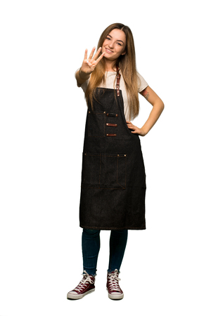 Full body Young woman with apron happy and counting four with fingers on isolated background