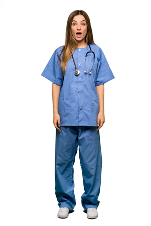 Full body Young nurse with surprise and shocked facial expression on isolated background