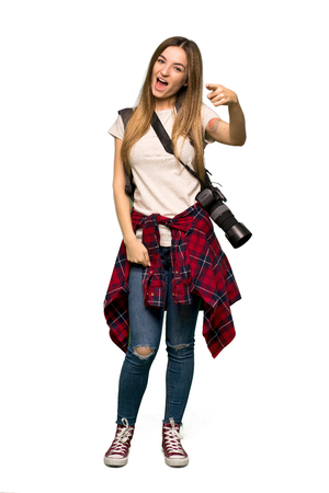 Full body Young photographer woman frustrated by a bad situation and pointing to the front on isolated background