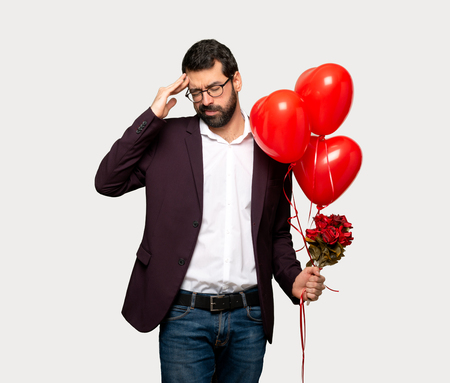 Man in valentine day unhappy and frustrated with something over isolated grey background