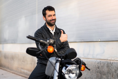Young man on a motorbike with thumb up Banque d'images