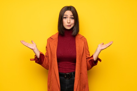 Young woman with coat unhappy because not understand something
