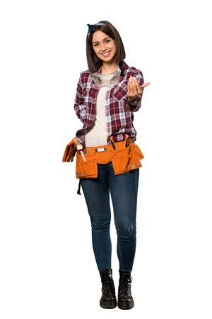 A full-length shot of a Young worker woman inviting to come with hand. Happy that you came over isolated white background
