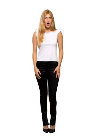 Young blonde woman with surprise and shocked facial expression over isolated white background Stok Fotoğraf