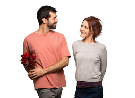 Couple in valentine day with flowers on isolated white background 스톡 콘텐츠