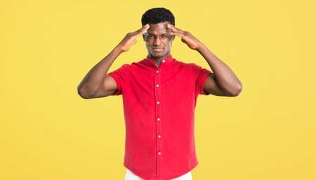 Young african american man unhappy and frustrated with something. Negative facial expression on yellow background