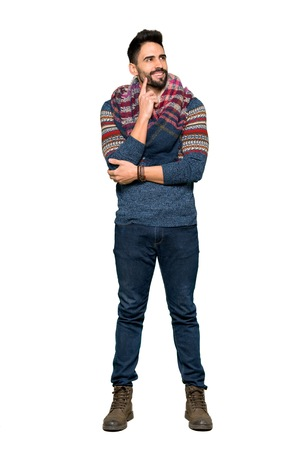Full-length shot of Hippie man thinking an idea while looking up on isolated white background Standard-Bild