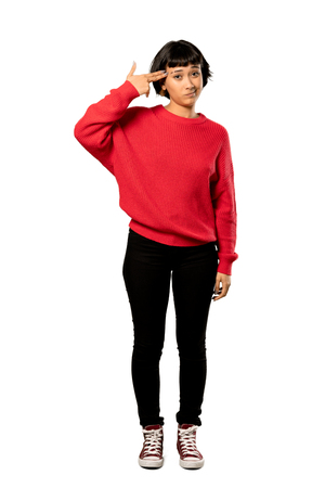 A full-length shot of a Short hair girl with red sweater with problems making gun gesture over isolated white background Banco de Imagens