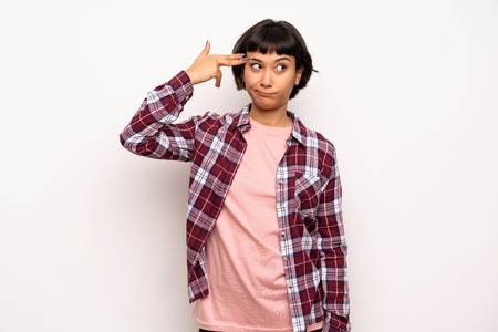 Young woman with short hair with problems making gun gesture