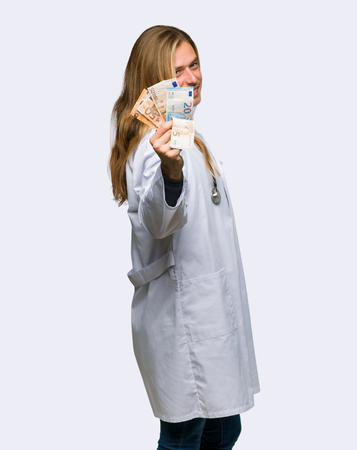 Doctor man taking a lot of money on isolated background Stok Fotoğraf