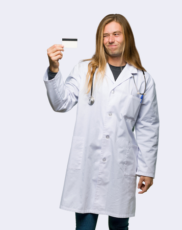 Doctor man taking a credit card without money on isolated background