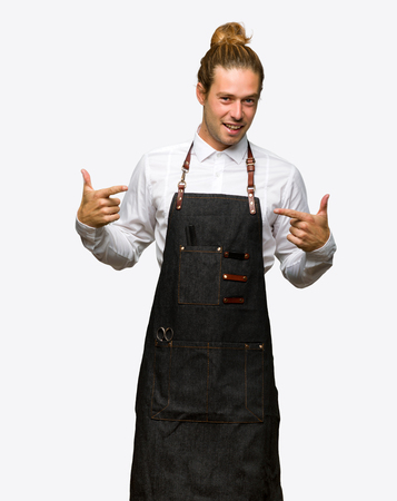 Barber man in an apron proud and self-satisfied in love yourself concept on isolated background Archivio Fotografico