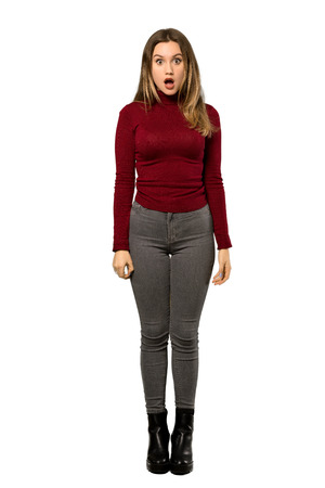 A full-length shot of a Teenager girl with turtleneck with surprise facial expression over isolated white background Stok Fotoğraf