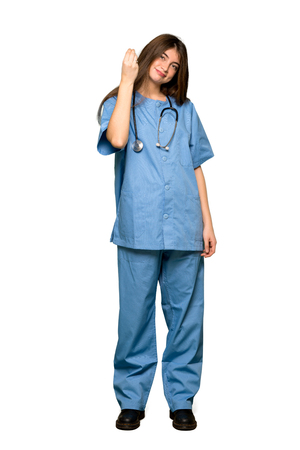 Full-length shot of Young nurse making Italian gesture on isolated white background