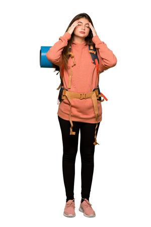 Full-length shot of Hiker girl unhappy and frustrated with something on isolated white background Reklamní fotografie