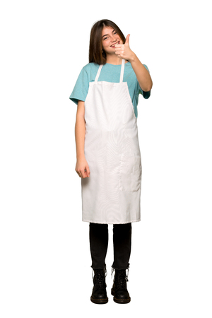 Full-length shot of Girl with apron giving a thumbs up gesture because something good has happened on isolated white background 版權商用圖片