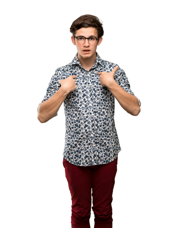 Teenager man with flower shirt and glasses with surprise facial expression over isolated white background Фото со стока