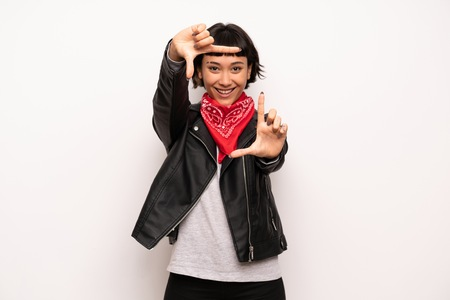 Woman with leather jacket and handkerchief focusing face. Framing symbol Stok Fotoğraf