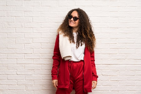 Teenager sport girl with curly hair with glasses and happy