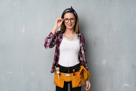 Craftsmen or electrician woman with glasses and surprised Фото со стока