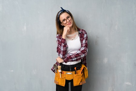 Craftsmen or electrician woman with glasses and smiling