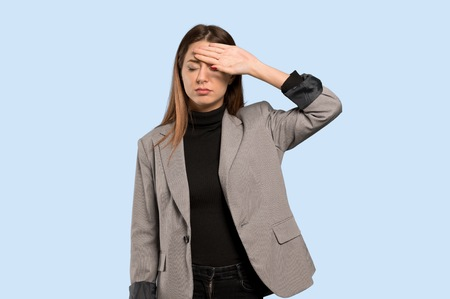 Business woman with tired and sick expression over isolated blue background