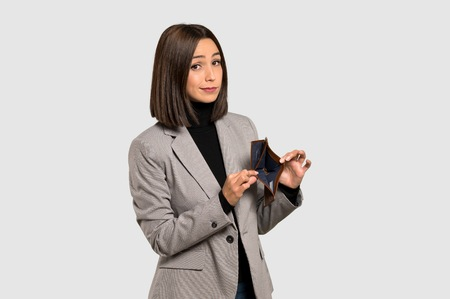 Young business woman holding a wallet on isolated grey background