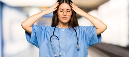 Young nurse unhappy and frustrated with something in a hospital
