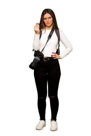 Full body of Young photographer woman making Italian gesture
