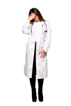 Full body of Young doctor woman with tired expression