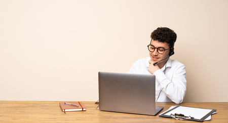 Telemarketer man with glasses and smiling