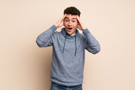 Young man over isolated wall with surprise expression Stok Fotoğraf