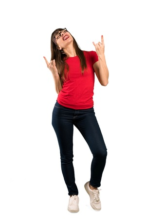 Full-length shot of Woman with glasses making rock gesture