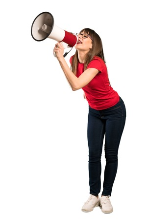 Full-length shot of Woman with glasses shouting through a megaphone